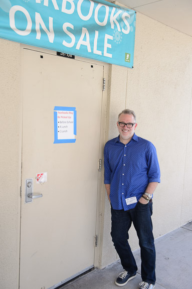 Tony stands outside the door of his old art room at South Fork HS